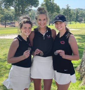 Chillicothe High School golf Lady Hornets (from left) Skyler Powers, Izzie Montgomery and Clara Leamer earned individual medals with top-10 finishes as they led CHS to the team title in the 2021 Midland Empire Conference Championships at the St. Joseph Country  Club course Monday, Sept. 27. Powers finished  third, Montgomery sixth, and Leamer ninth.