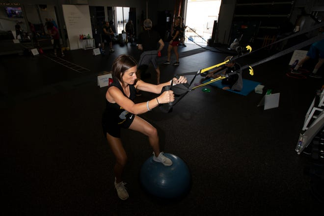 Jessica Krauser performs a warm-up exercise during a morning workout at pDNextSteps,a gym in Dublin that's specifically for those with Parkinson's disease. Krauser was diagnosed with young-onset Parkinson's two years ago at age 37.