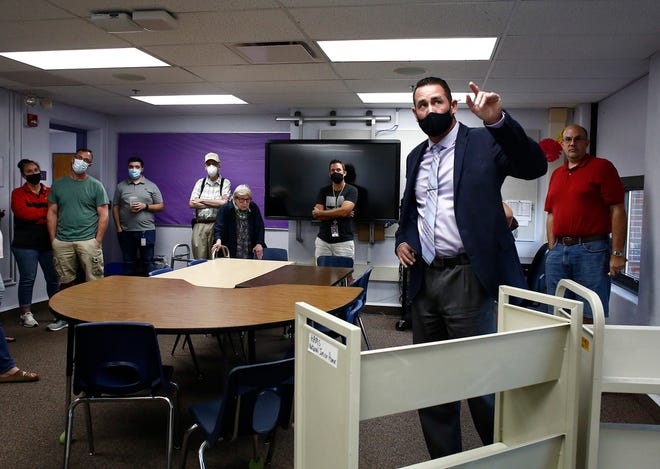 Chris Reed, executive director of business for Reynoldsburg schools, points to water damage in a third-floor classroom at Hanna Ashton Middle School. The district  has a 4.9-mill bond issue on the Nov. 2 ballot that would provide funds to replace the 153-year-old school.