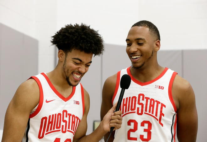Zed Key (23) is interviewed by teammate Harrison Hookfin (42) during media day for the Ohio State men's basketball team at Value City Arena in Columbus on Tuesday, September 28, 2021.