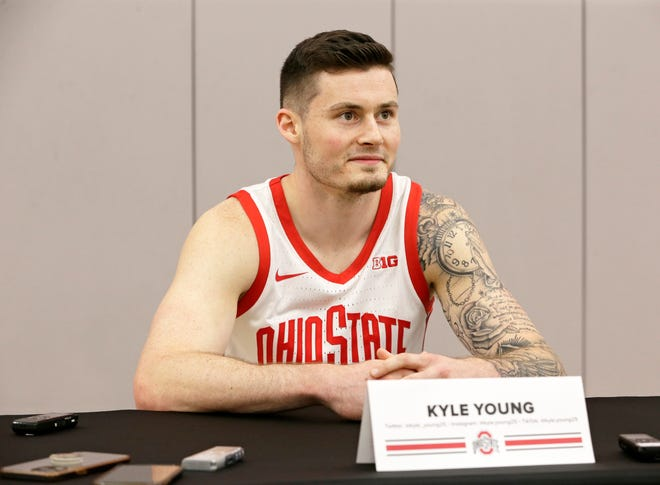 Kyle Young (25) takes questions from reporters during media day for the Ohio State men's basketball team at Value City Arena in Columbus on Tuesday, September 28, 2021.