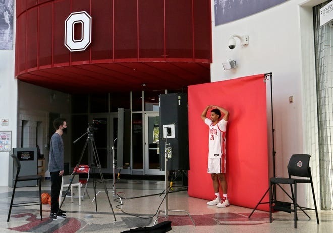 """Seth Towns (31) forms an """"O"""" with his arms while being filmed in the northwest rotunda during media day for the Ohio State men's basketball team at the Schottenstein Center in Columbus on Tuesday, September 28, 2021."""
