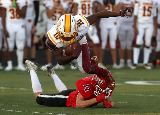 Westerville South's Jack Bates trips up Westerville North's Stanley Jackson during their game Sept. 24. The host Wildcats won 62-21. On Oct. 1, South plays host to Delaware and North plays host to Canal Winchester.