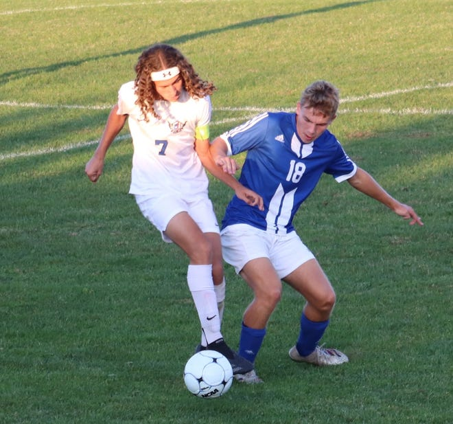 Zanesville's Evan Dinan (7) and Cambridge's Steeler Sylvis (18) battle for possession in the Bobcats' 4-0 win on Tuesday.