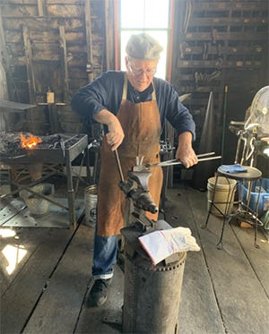 Ken Pilarczyk works a piece of metal into a candleholder at the Saurer Blacksmith Shop at Sonnenberg Village during the 2019 Beet Festival. The festival this year will be held Saturday, Oct. 16 in Kidron.