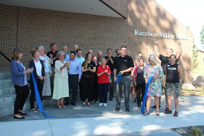 The ribbon is cut on Thursday, Sept. 16 at Raccoon Valley Bank in Adel. An open house was also held to show off the bank's recent interior remodel and landscaping updates.