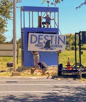 Sign goes up at Destin High School on Sept. 23.
