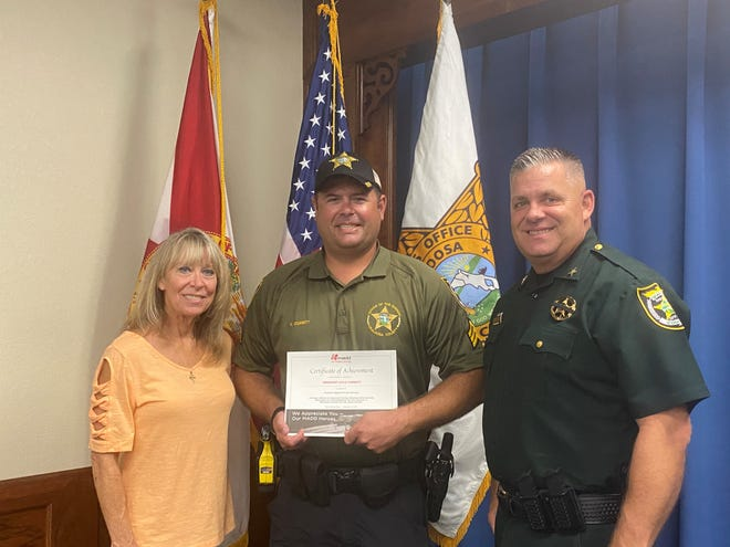 At presentation are Amy Jamieson of MADD of NW Florida, Sgt. Kyle Corbitt, and OCSO Sheriff Eric Aden.