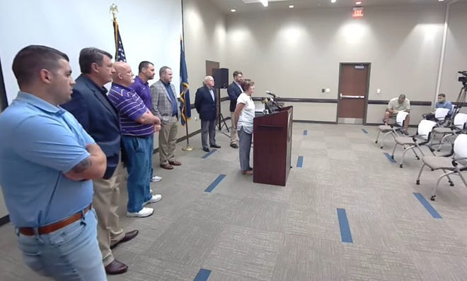 Ascension Parish President Clint Cointment and Ascension Parish Council members who serve on the East Ascension Drainage Commission speak during a press conference Sept. 29 in Gonzales.