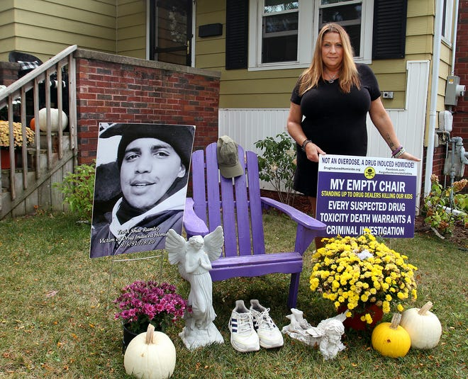 Sarah Fowler stands next to an Empty Chair display on Sunday, Sept. 26, 2021, in her yard in Freeport. Fowler's display honors her boyfriend, Tevin Rumley, who died of fentanyl poisoning. Fowler's display is part of a national campaign to raise awareness of lives lost to drug-induced homicide.