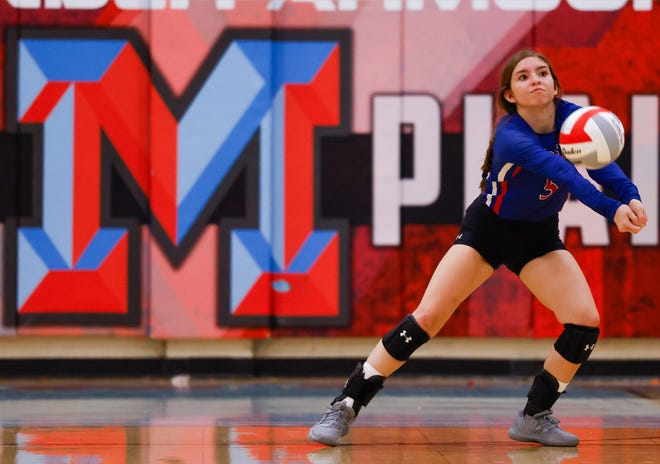 Cooper's Lexie Fernandez (5) hits the ball during the Lady Coogs' District 4-5A match against Monterey on Tuesday in Lubbock.
