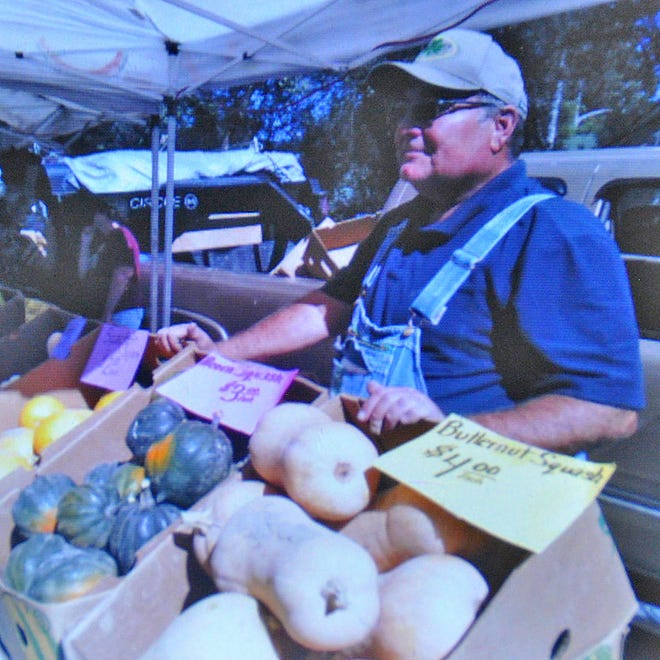 Chuck Hanagan greets customers at the Old Colorado City farmers market in Colorado Springs. His family has had a presence at the market for nearly 40 years. Hanagan said direct interaction with grateful customers restores his optimism at a time when agriculture is facing threats from impractical or unrealistic policies and regulations.