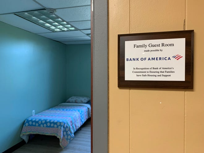 """The Bank of America """"Guest Room"""" is officially named at the Volunteers of America Family Shelter in Rochester. A ribbon-cutting ceremony was held to celebrate the naming of the room in recognition of Bank of America's support for VOA's emergency shelter, which serves homeless families."""