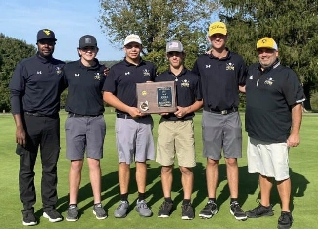 Bookended by coaches Josh Blowe and Bill Ack, Keyser golfers Evan Ack, Dylan Wilson, Noah Broadwater, and Drew Matlick celebrate winning the regional championship, and earning a trip to the state tournament for two years running.