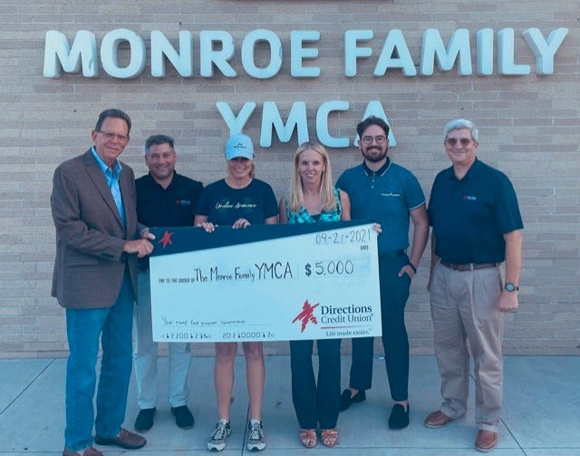 Directions Credit Union presented a donation to the Monroe Family YMCA for its Meal Distribution Program. Pictured are (from left): Ray Leighton, Directions board member; Brian Epstein, Directions' CXO;  Dawn Brodie, Directions board member; Kristin Irwin, chief executive officer of the Monroe Family YMCA; Luke Grable, Directions' community outreach and education coordinator, and Barry Shaner, chief executive officer for Directions. Courtesy photo