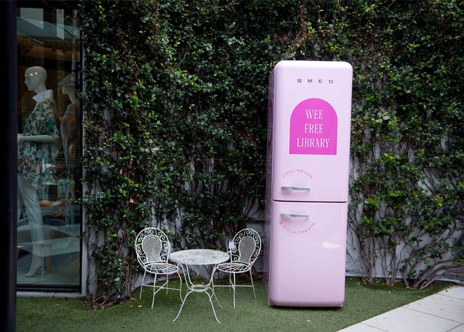 The Royal Poinciana Plaza opened the new Wee Free Library Monday in Palm Beach. Housed in a pink Smeg refrigerator,  the library holds books, crayons, and coloring books in the top drawer, and complimentary popsicles in the bottom drawer.