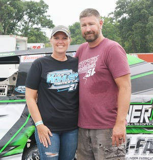 Mike Mosier, here with his wife, Lindsay, this summer at Fairbury Speedway, has returned to racing after encouragement from Lindsay.
