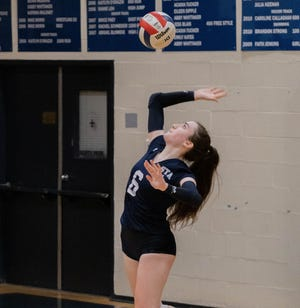 St. Thomas Aquinas senior captain Mya Ford delivers a serve during Monday's Division II volleyball match against Manchester Central.
