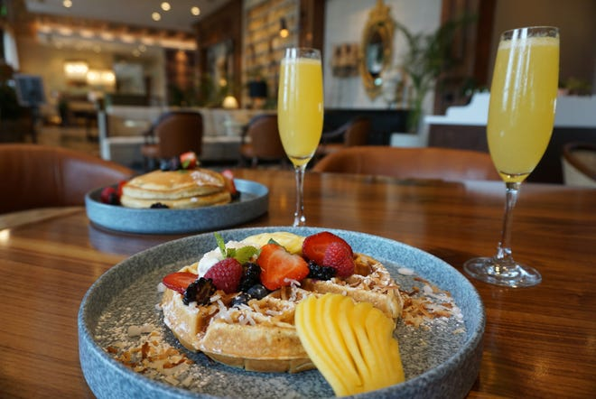 Waffles and pancakes are on the brunch menu at Proper Grit restaurant, located inside The Ben hotel in West Palm Beach.