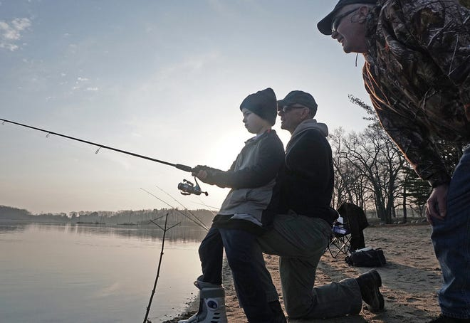 Grady LaMarche of North Kingstown gets help from both of his grandfathers on the opening day of trout-fishing season in April 2018 at Olney Pond in Lincoln Woods. Next to Grady is John McDermott of Cranston and at right is Bob LaMarche of Warwick.