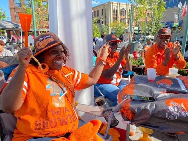 Seneca Holmes, of Canton, roots for the Browns at Centennial Plaza in downtown Canton. The venue has become a popular spot to watch Browns games, including the Sept. 26 matchup against the Chicago Bears.