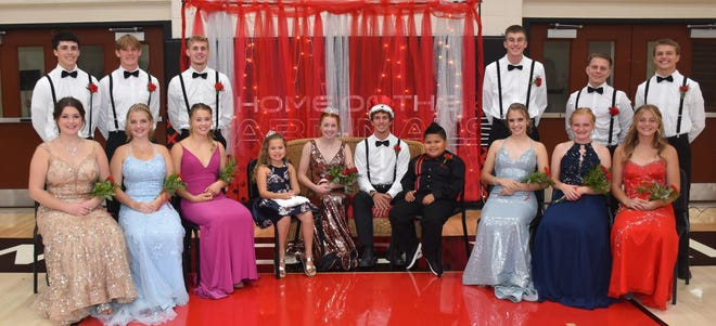 Coronation was held at Redwood Valley High School Tuesday evening with the crowning of Queen Kate and King Maverick. Pictured is the Homecoming Court, front from left: Brooke Fischer, Kate Foy, Ella Fuhr, Brooklyn Bernhardson, Kate Ahrens, Maverick Goblirsch, Russell Means, Jahlyn Bill, Payton Schueller, and Catherine Buffie. Back: Isaac Louwagie, Austin Altmann, Alex Lang, Jahger Bill, Henry Buffie, and Drew Lundeen. MCs for the evening were Nolan Smith and Ellie Mertens. The program included an update on all events for the week, coaches or captains speeches, and a Homecoming Court Family Feud show.  Sports this week: Thursday - Home CC Meet; Tennis at Fairmont. Friday - Football vs. JCC. Also Friday - Pepfest at 12:15 and Homecoming Hangout for grades 9-12 after the game.