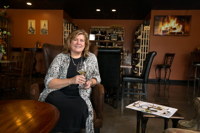Owner Connie Kieffer poses with a glass of wine on Wednesday, Sept. 29, 2021, at After The Vine, 163 Hawick St., in Rockton.