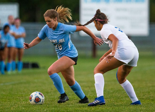 Saint Joseph's Ella Frick tries to keep the ball away from Marian's Tori Tellez during the Marian vs. Saint Joesph girls soccer match Tuesday, Sept. 28, 2021 at the Northfield Athletic Complex in South Bend.