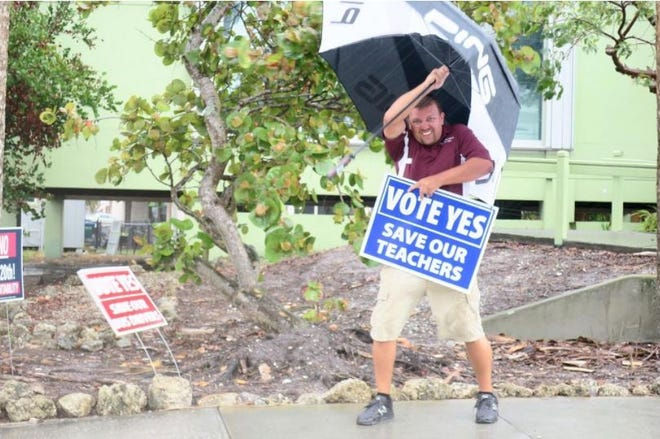 King Middle School teacher Jon Syre campaigns in 2018 for the School District of Manatee County's one-mill property tax. The 2018 referendum passed, and it is up for renewal in a countywide special election on Nov. 2.  [Herald-Tribune archive photo/2018]