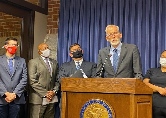 Brian Richard, of the Northern Illinois University Center for Governmental Studies, is pictured at a news conference Wednesday at the state Capitol. He is the author of a report showing the economic impact of community colleges.
