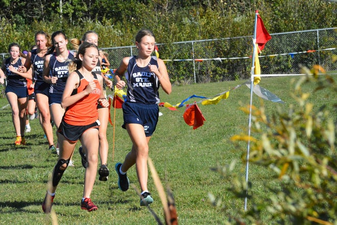 Kaylen Clark of Newberry, left, and Cassandra Gallagher of Sault High, right, lead the girls varsity race at the Straits Area Conference II cross country jamboree Monday at the Lynn Trails course. Clark and Gallagher finished 1-2 in the race.