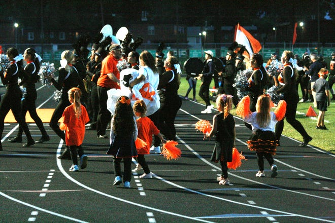 Kewanee's littlest pom pon girls follow their older counterparts off the field after halftime of last week's Homecoming football game against Princeton. The numbers of fans at Boilermakers' games has grown each week as the program has had its best start since 1999.