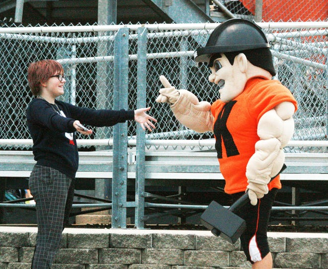 The Boilermaker mascot and a fan negotiate the parameters of a greeting at last week's Homecoming game.