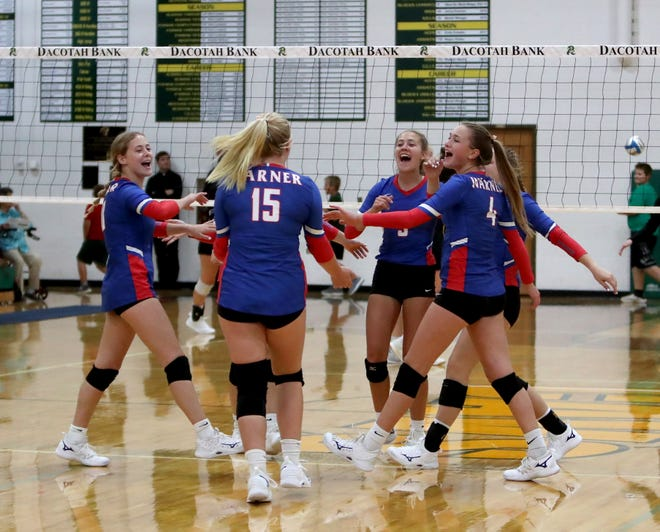 Warner's volleyball team celebrates after Kamryn Anderson sinks an ace against Aberdeen Roncalli during the first set of Tuesday's match at the Roncalli gym. American News photo by Jenna Ortiz, taken 09/28/2021.