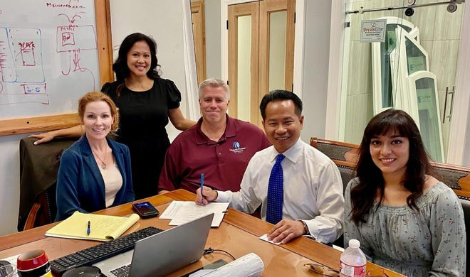 Dreamline Windows and Doors signed a deal to purchase an additional 7.5 acres in the Cold Springs Industrial Park. From Left: Van Alstyne Community & Economic DevelopmentExecutive Administrator Tiffany Chartier, realtor Trang Dang-Le,Community andExecutiveDevelopmentDirector Rodney Williams,Dreamline Chief Operating Officer TuHuynh, andBianca Landa of the wholesale division.