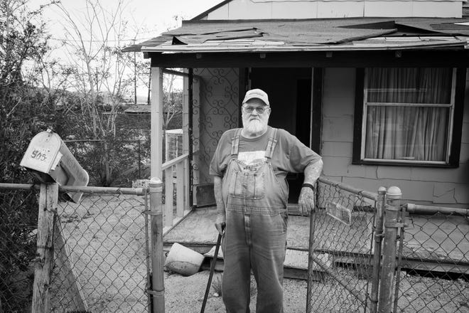 Ira Gwin owns Hillside Apartments in Barstow, and is a longtime resident of the city. Here, he is photographed by Lara Hartley in front of one of his rental homes prior to a remodeling he did in 2014.