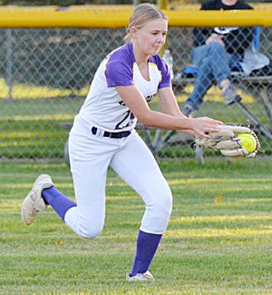 Centerfielder Kinsley Van Gilder of the Watertown Arrows makes a running catch Tuesday during a high school girls fastpitch softball doubleheader against Sioux Falls Lincoln at Koch Complex. Lincoln swept the twinbill.