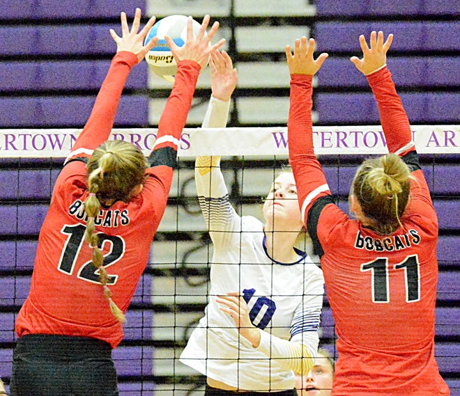 Watertown's Emma Koch (10) spikes the ball against Brookings' Gracie Adams (12) and Taylor Dobrenski during their high school volleyball match Tuesday night in the Civic Arena. Brookings won 3-1.