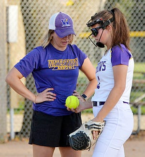 Assistant coach Elli Stevenson (left) visits with Watertown Arrows pitcher Jada Brown during a high school girls fastpitch softball doubleheader against Sioux Falls Lincoln this fall at Koch Complex. Brown later helped the Arrows close out the week and their season by going 3-2 and finishing fourth in the state Class A tournament at Sioux Falls. Members of the team spearhead the Public Opinion's list of top area performers this week.