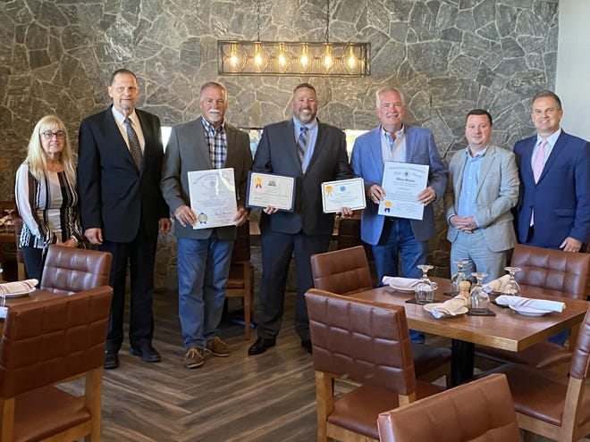 Grille 151. Ιδιοκτήτης εστιατορίου [fourth from left) and business partners Scott Galvin, third from left) and Sean Galvin, (fifth from left) display complimentary citations presented on Sept. 29 by District 2 Councilor Pascale Burga, (first from the left) State Sen. Patrick O'Connor, (sixth from the left) and State Rep. James Murphy, D- Weymouth. (Seventh from left)  Mayor Robert Hedlund (Second from left) participated in a ribbon cutting ceremony before the citations were presented.