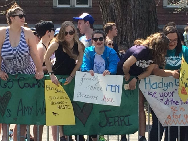 """Wellesley College students are famous for their signs encouraging Boston Marathon runners. These are some of the best ones we saw while standing in the """"Scream Tunnel"""" in 2016."""