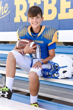 Kage McDonald, 12, played football for Westwood Junior High School in Sloan, Iowa. McDonald, 12, died Friday when he fell off a float during the Westwood High homecoming parade. The high school's football team honored McDonald by painting his No. 3 in the end zones and painting each No. 3 on the 30-yard-lines blue.