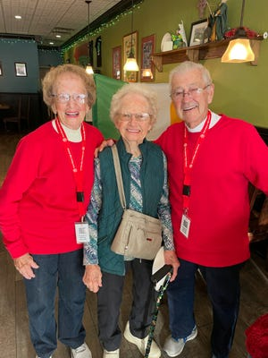 Port Clinton High School grads were greeted at each decade gathering location by alumni hosts Sept. 25 in downtown Port Clinton.  Here Rosella and Richard Stein are ready to greet alumni from the 1940s and 1950s at McCarthy's.  In the center is Joanne Lasky Hockin, the earliest graduate in attendance from the Class of 1942.