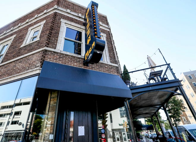 A Heiden Plumbing, Heating and Cooling employee is seen entering Pizza Man. Henry's Pub and Grille has encountered numerous water leaks from Pizza Man's second-floor kitchen in Milwaukee.