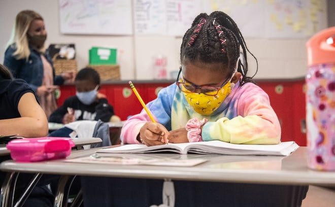 Jekiera McDougal, 7, works on a math assignment at Rosebank Elementary School in Nashville, Tenn. on Tuesday, Sept. 28, 2021.