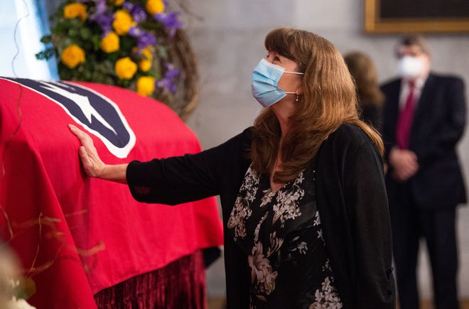 Executive Administrative Assistant Lisa Hazlett-Wallace touches the casket that holds Tennessee Supreme Court Justice Connie Clark, in the Old Supreme Court Chambers at the Tennessee State Capital in Nashville, Wednesday, Sept. 29, 2021. Justice Connie passed away on Sept. 24 after a short battle with cancer.