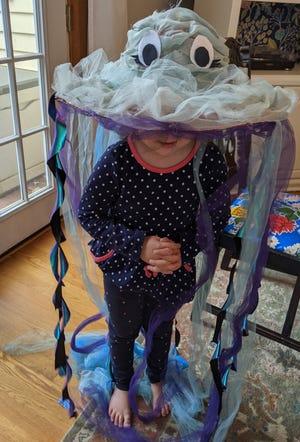 Tiny models Bookworm's 2020 Halloween costume, a jellyfish.