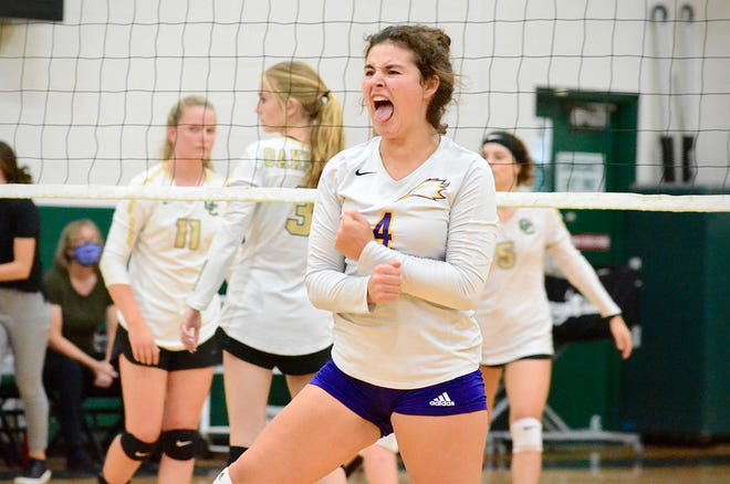 Plymouth Christian Academy senior Hallie Creighton celebrates her volleyball team scoring a point during a Michigan Independent Athletic Conference-Blue match Tuesday, Sept. 28, 2021, at Auburn Hills Oakland Christian School.