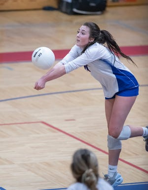 Ellie Harshany (14) plays the ball during the Milton vs Pace volleyball match at Pace High School on Tuesday, Sept. 28, 2021.