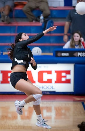 Camille Germann (5) plays the ball during the Milton vs Pace volleyball match at Pace High School on Tuesday, Sept. 28, 2021.